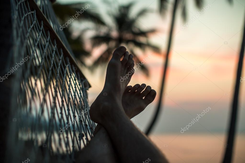 Legs in a hammock on the beach