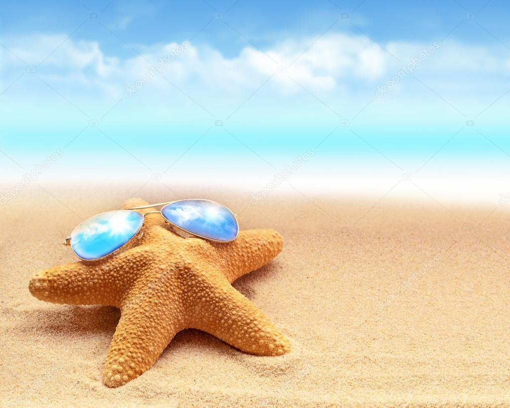 Summer beach. starfish in sunglasses