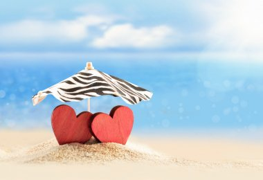 Two hearts under umbrella on the summer beach. Valentines day. stock vector