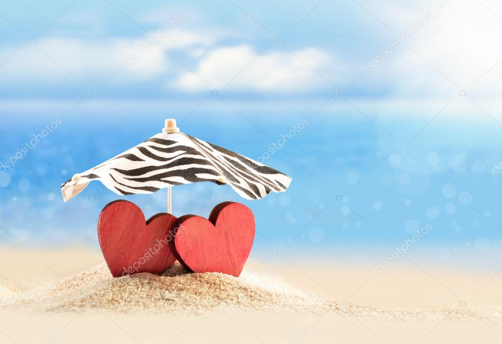 Two Hearts Under Umbrella On The Beach Valentines Day Stock