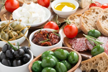 assorted Italian antipasti - olives, salami, pickles and bread