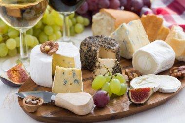 Cheese platter, snacks and wine, horizontal stock vector