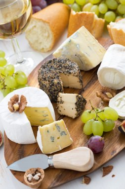 cheese platter, snacks, bread and wine, vertical