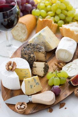 cheese platter, snacks, bread and wine