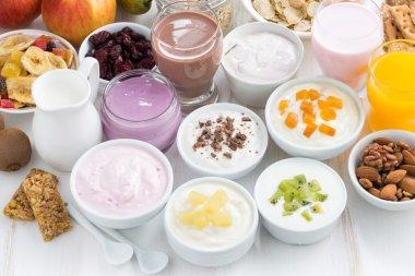 Assorted fresh fruit yoghurts and breakfast ingredients