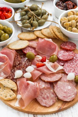 Assorted meat snacks, sausages and pickles, top view, close-up