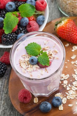 delicious berry smoothies with oatmeal, vertical, top view