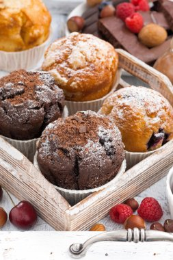 Assortment of fresh delicious muffins and fresh berries