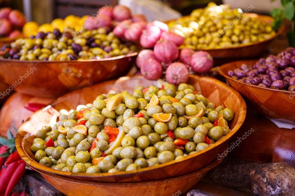 Marinated garlic and olives on provencal street market in Proven