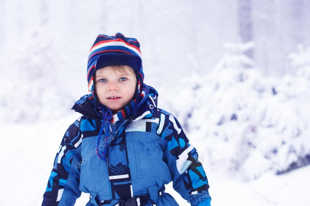 daba63d0c Little toddler boy having fun with snow outdoors on beautiful wi ...