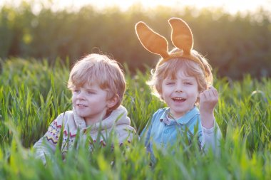 Two children playing with Easter bunny ears