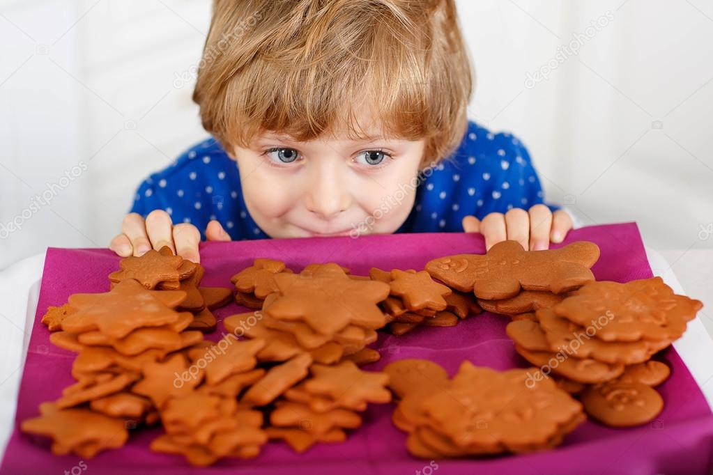 Little kid boy baking Christmas cookies at home — Stock Photo ...