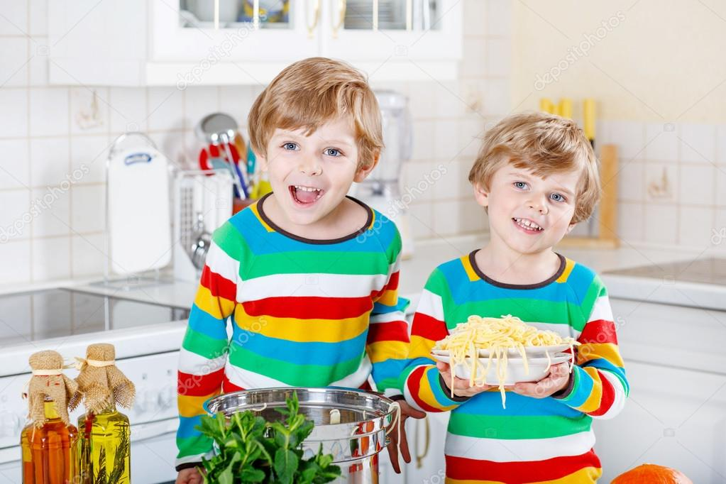 Two Little Kid Boys Eating Spaghetti In Domestic Kitchen Stock Photo Friends Having Fun
