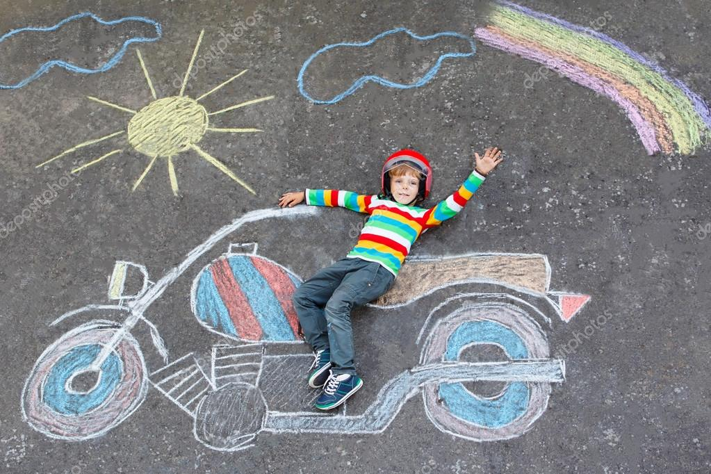 Little kid boy in helmet with motorcycle chalks picture — Stock ...