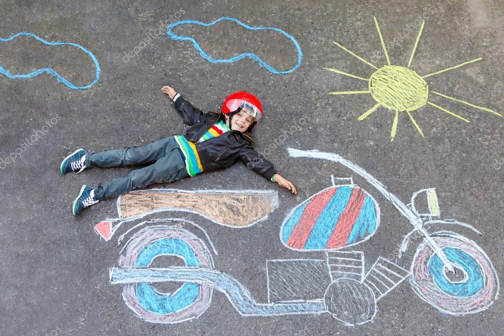 Little kid boy in helmet with motorcycle chalk picture — Stock Photo ...