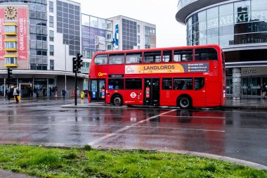 London UK, March 26 2021, Red Double Decker Public Transport Bus At Traffic Lights On A Empty Street.