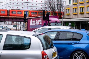 London UK, March 26 2021, Traffic Jam With A Railway Train Crossing A Road Bridge In Front Of High Rise Buildings