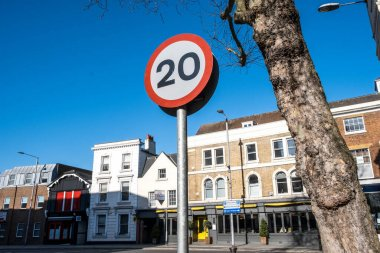 Kingston, London UK, April 7 2021, 20mph Road Speed Limit Traffic Sign Against A Blue Sky With No People