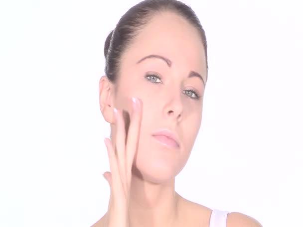 Young Woman Applying Skin Moisturising Cream