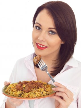 Young Woman Eating Lamb Rogan Josh Indian Curry