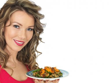 Young Woman Eating a Chicken Tikka and Rice Salad