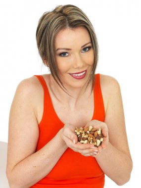 Young Woman Holding a Handful of Mixed Nuts