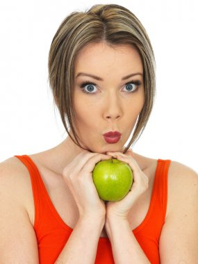 Young Woman Holding a Fresh Ripe Green Apple