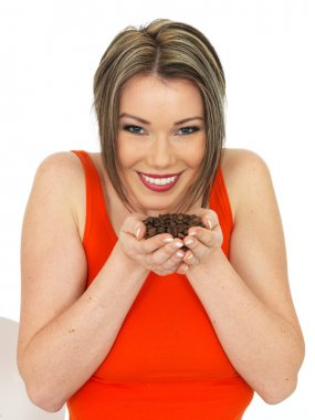 Young Woman Holding Fresh Roast Coffee Beans