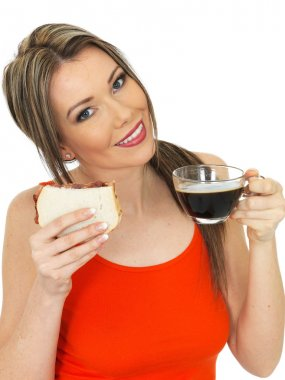 A DSLR royalty free image, of an attractive healthy, happy, beautiful young woman, wife or girlfriend,  holding and eating food, wearing a red vest top against a white background. Close up studio shots with lots of facial expressions stock vector