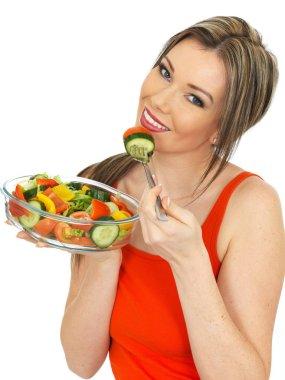 Young Woman Eating a Fresh Garden Salad