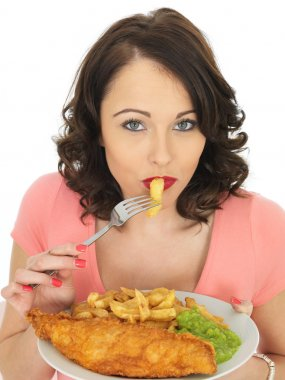 Young Woman Eating Fish and Chips with Mushy Peas