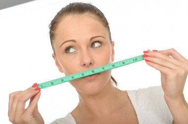 Healthy Young Woman Holding a Tape Measure