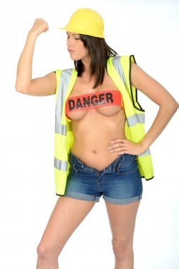 Sexy Young Pin Up Woman Posing Topless in Builders Clothes