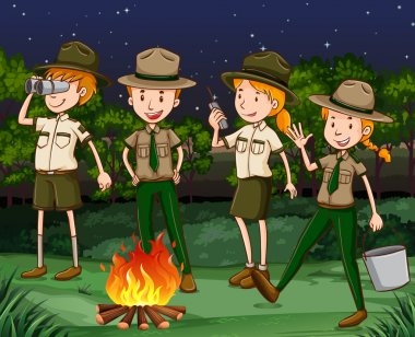 Park rangers at the campfire