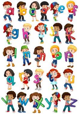 Children holding english alphabets