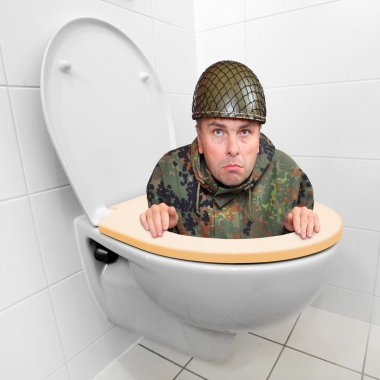 Cowardly soldier hiding in the toilet bowl