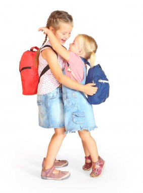 Two sisters with school bags