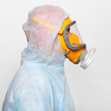 Man in protective clothing with respirator.