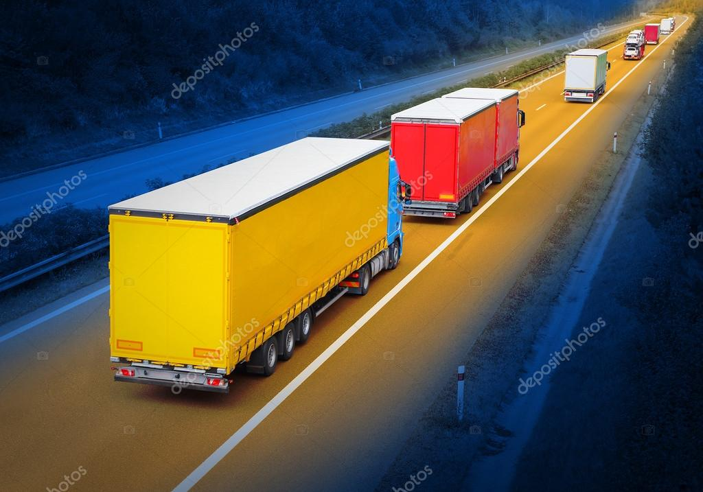 The trucks on the highway.