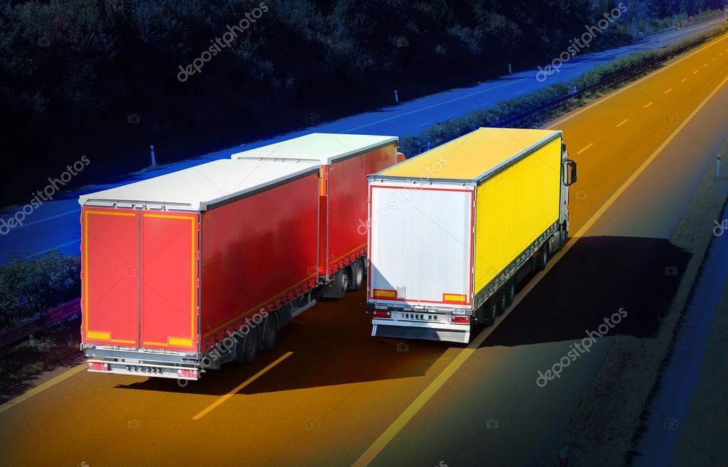 The trucks on a highway.