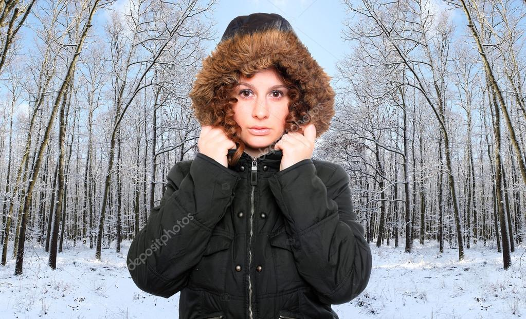 Young woman dressed in warm jacket