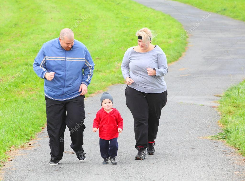 Overweight parents with her son walking together