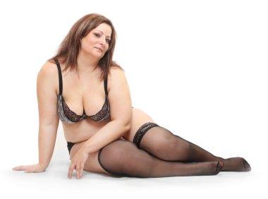 Overweight woman dressed in bikini.