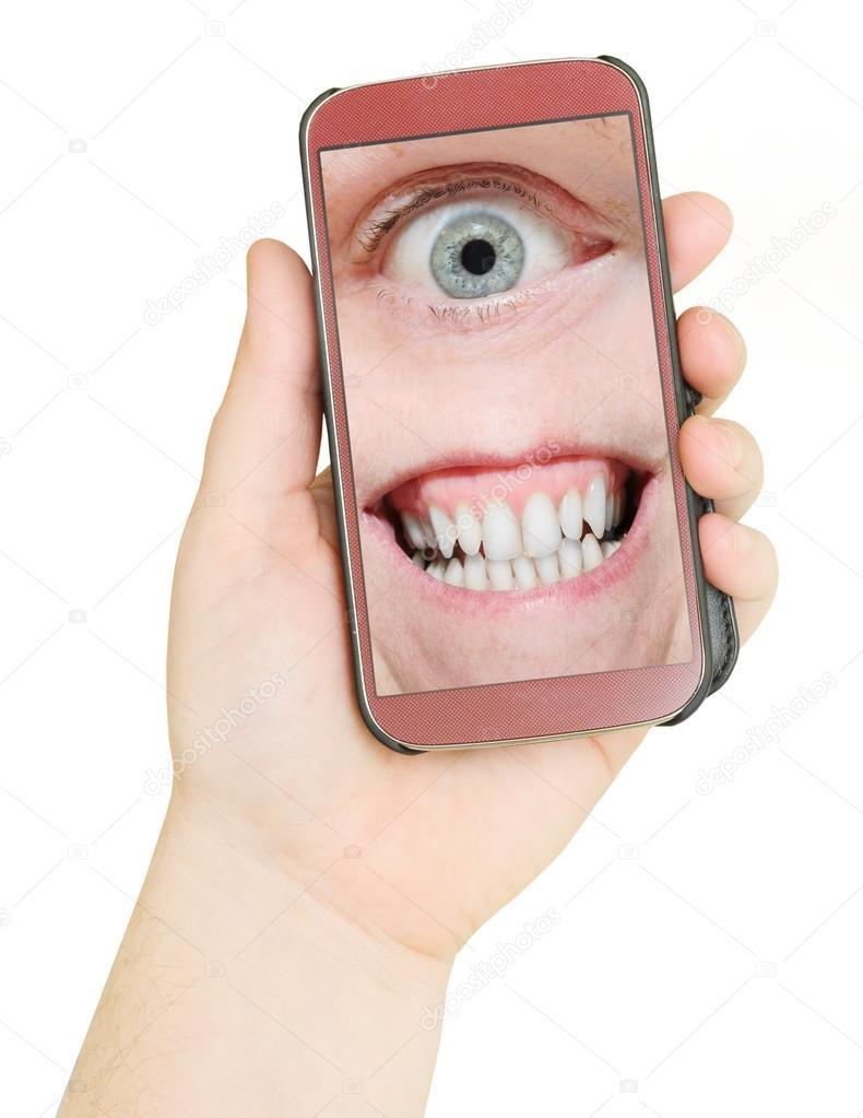 Handy Mit Augen Und Zähne Stockfoto Vladvitek 65979005