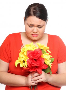 Overweight woman with flowers
