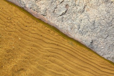 Stone and sand on the lakeside