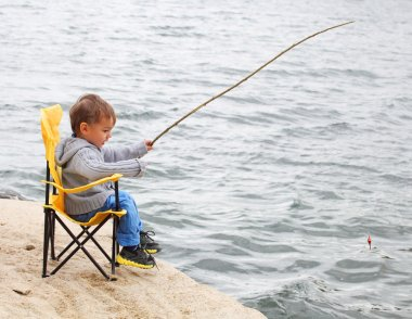 Little boy catching a fish
