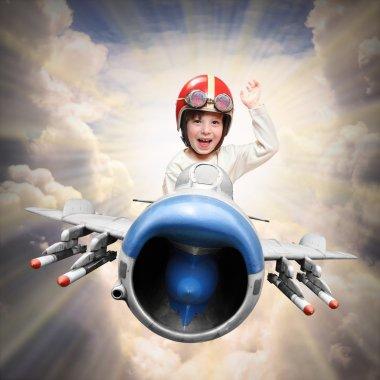 Happy little pilot flying in retro jet fighter. stock vector