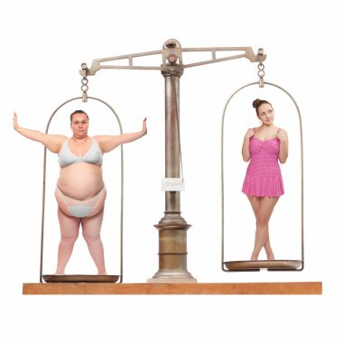 Overweight and slim. Balance scale with two young women