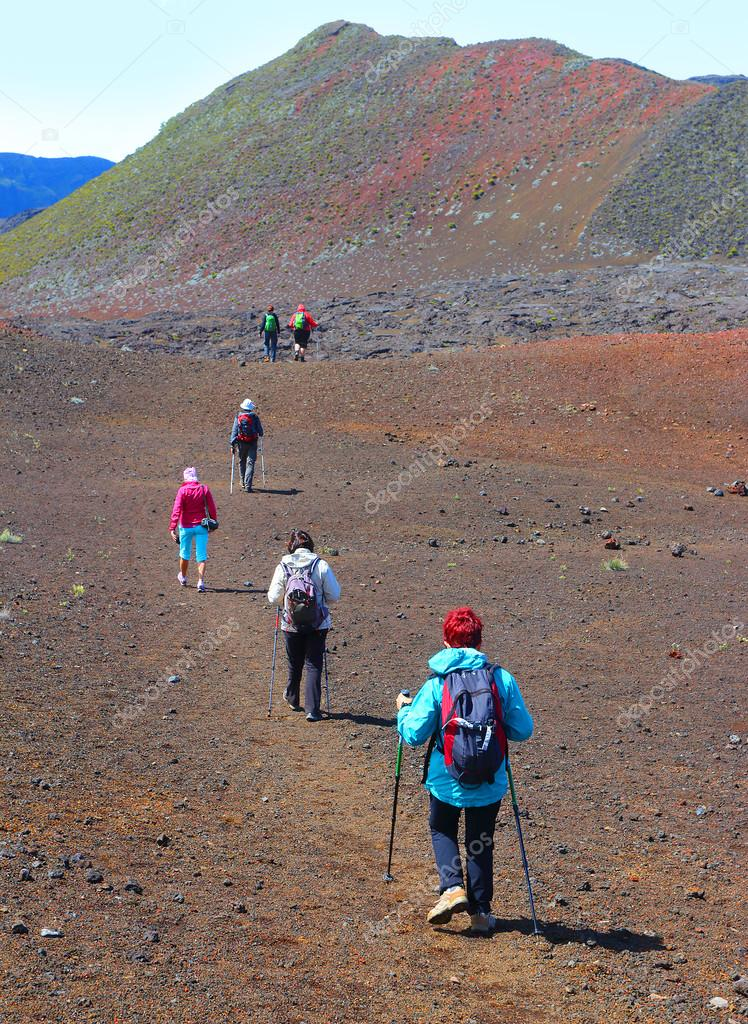 Group of hikers walking on Piton de la Fournaise
